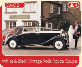 White and black vintage Rolls Royce Coupe wedding car for rental from Broadoak, Manchester.