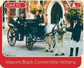 Masons black convertible Victoria wedding horse and carriage.