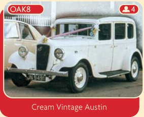 A gorgeous cream vintage Austin Wedding Car.